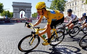 492090-sky-procycling-rider-and-leader-s-yellow-jersey-bradley-wiggins-of-britain-takes-a-curve-in-paris-du