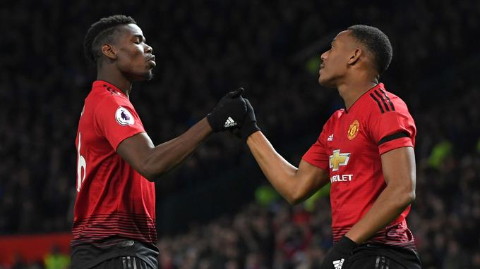 Manchester United's French striker Anthony Martial celebrates with Manchester United's French midfielder Paul Pogba (L) after scoring their second goal during the English Premier League football match between Manchester United and Everton at Old Trafford in Manchester, north west England, on October 28, 2018. (Photo by Paul ELLIS / AFP) / RESTRICTED TO EDITORIAL USE. No use with unauthorized audio, video, data, fixture lists, club/league logos or 'live' services. Online in-match use limited to 120 images. An additional 40 images may be used in extra time. No video emulation. Social media in-match use limited to 120 images. An additional 40 images may be used in extra time. No use in betting publications, games or single club/league/player publications. /
